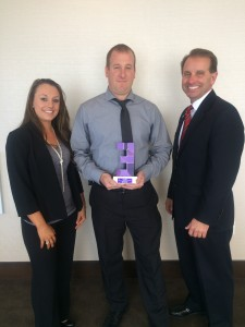Empower employment counselors, Jennifer Burns (left) and Mike Marra (right) present Robert Gordon (middle), C&W Services District Manager, with the Employer of the Year award in October
