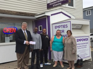 Empower CEO Jeff Paterson along with Community Prevocational Program participants Mike, Jamius and Robin receiving $24,719 check from KeyBank Senior Vice President and Regional Corporate Responsibility Officer Cathy Braniecki