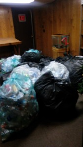 15 bags of bottles and cans collected by the Outlet Mall and ready for sorting