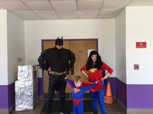 Batman, Superboy and Wonder Woman took time away from saving the world to greet propsective students at the Children's Academy open house