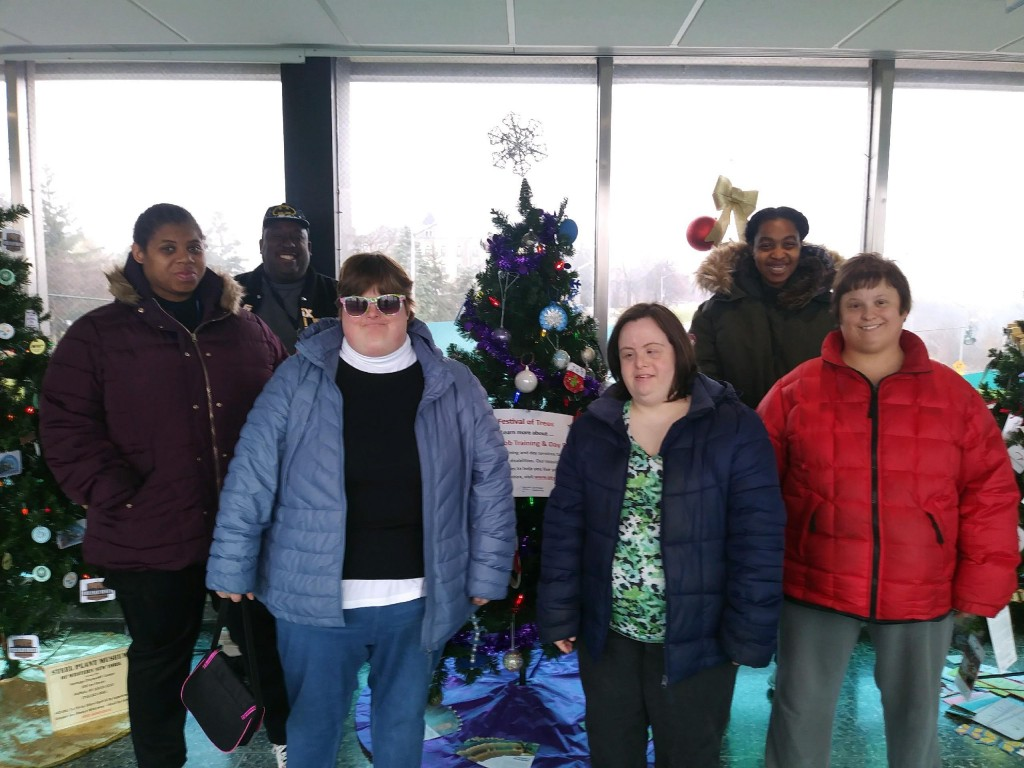 Crystal, Wendell, Becky, Tabitha and Tamara proudly stand in front of their decorated tree