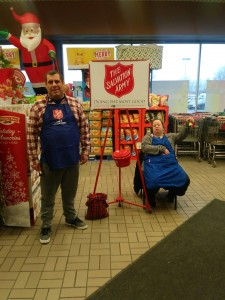 Sam and Tabitha ringing the Salvation Army bell at Tops in Niagara Falls