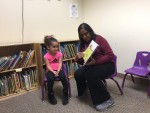Ms. Shaila, one of our special education teachers, reading with a student whose speech improved because of their reading sessions