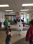 Olaf dancing with students during our winter wonderland festival
