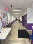 Hallway next to front office, that has two classrooms and the physical therapy and occupational therapy/sensory rooms