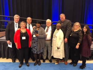 Ernestine Gayle (second from left in front row) was honored at Robert Schonhorn Direct Support Professional of the Year award at Cerebral Palsy Associations of New York State conference