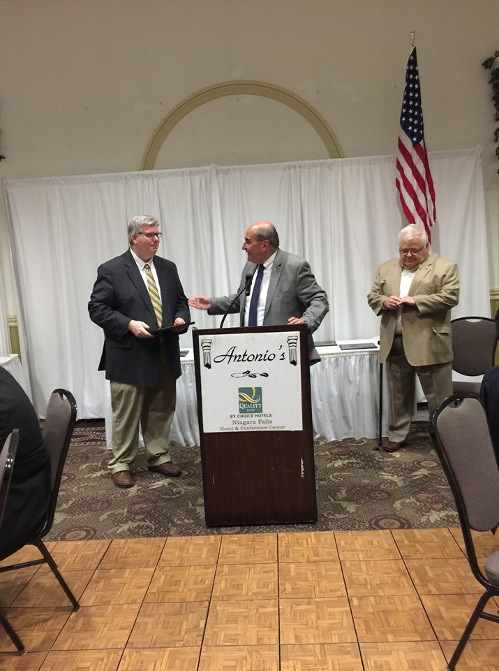 Chief Executive Officer Jeff Paterson receivinghis 5 years of service award from Board President Tom Caserta