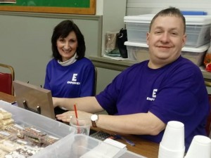 Russ Polvino (right), CP State awardee, selling cookies and fudge at annual Basket Auctioun